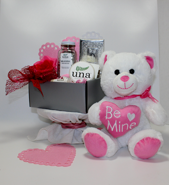 """This is a visual representation of the best valentine's day gifts in Pittsburgh featuring Una Biologicals spa gifts, Betsy Ann Chocolates, Scamps Toffee and a soft and cuddly """"Be Mine"""" Teddy Bear."""