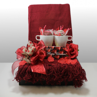 The Valentines day gift is visual image of the best valentines day gift in Pittsburgh. Cuddle With Me includes a large, warm knit basket with sweet chocolates and cocoa bombs / mugs. The best Valentine's Day gifts in Pittsburgh!