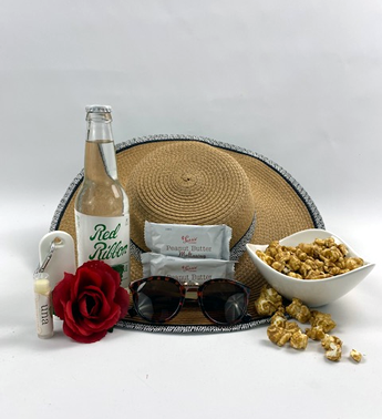 This image is showcase the gift basket Hats off to Summer by Basket of Pittsburgh and shows the quality, quantity and contents of the beautiful mothers day gift.